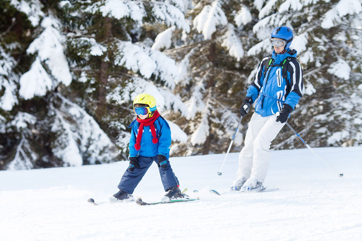 Father and son skiing